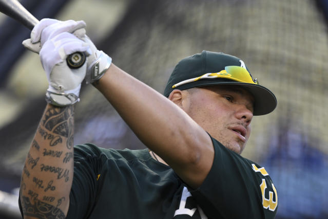 Oakland Athletics' Bruce Maxwell will serve probation and community service on a plea deal stemming from his October assault arrest. (AP Photo/Michael Owen Baker)