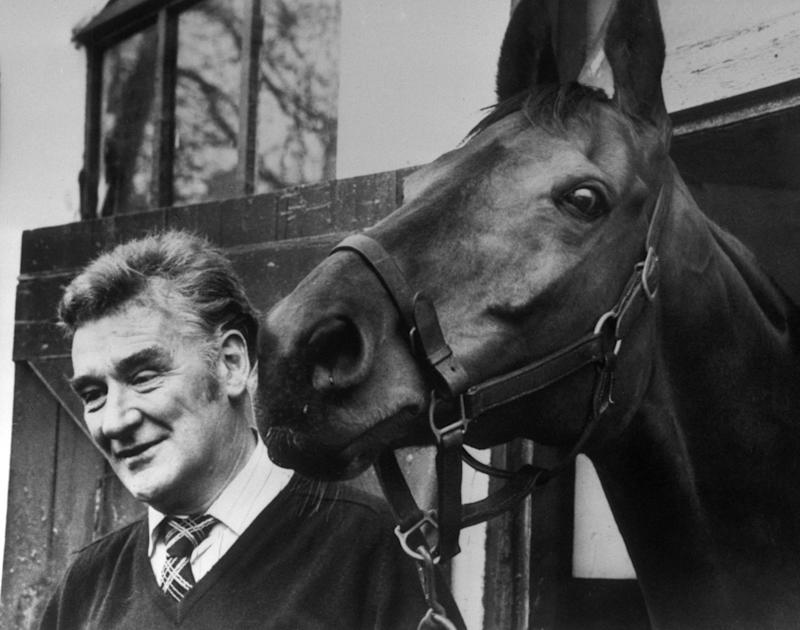 """Horse Racing - Ginger McCain Filer...File photo dated 30/03/1974 of Trainer Donald """"Ginger"""" McCain with legendary three-time Grand National winner """"Red Rum"""" in his stables at Southport. PRESS ASSOCIATION Photo. Issue date: Monday September 19, 2011. Aintree legend Ginger McCain, trainer of the great Red Rum, has died aged 80. McCain saddled Red Rum to win the Grand National three times, in 1973, 1974 and 1977, before winning the Aintree marathon for a fourth time with Amberleigh House in 2004. See PA Story RACING McCain. Photo credit should read: PA Wire - Credit: PA Wire"""
