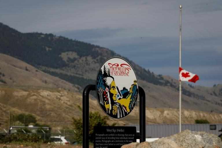 A Canadian flag hangs at half-mast at the Tk'emlups RCMP detachment near the former Kamloops Indian Residential School, where the remains of 215 children were found