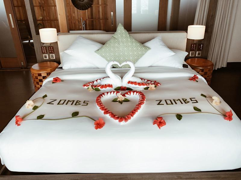 Upon arrival at Kudadoo Maldives. ZOMBS️ZOMBS written in flowers on our bed.