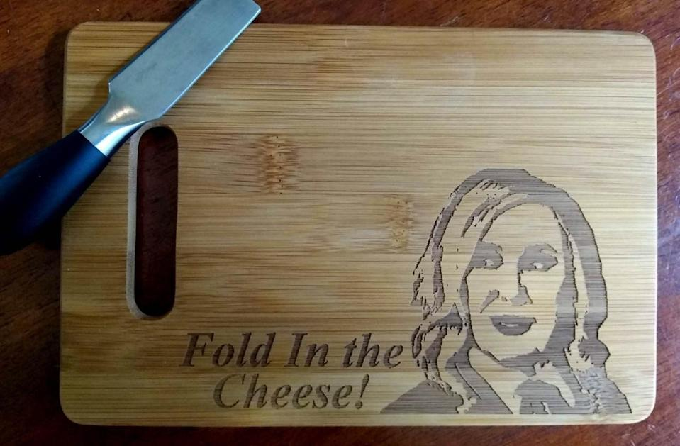 """<p>They can't fold in the cheese with this <span>""""Fold in the Cheese"""" Cutting Board</span> ($13), but they can certainly cut it. </p>"""