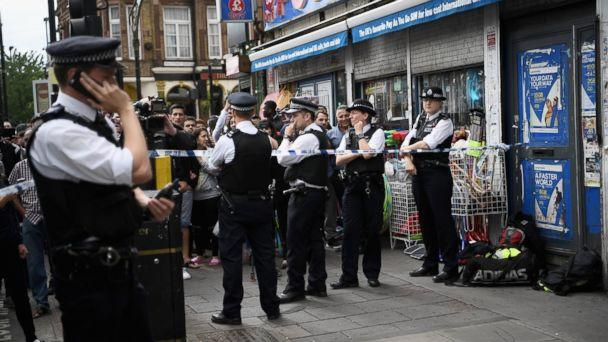 PHOTO: Police officers stand outside a property in East Ham which has been raided by police, June 4, 2017 in London, England. (Carl Court/Getty Images)
