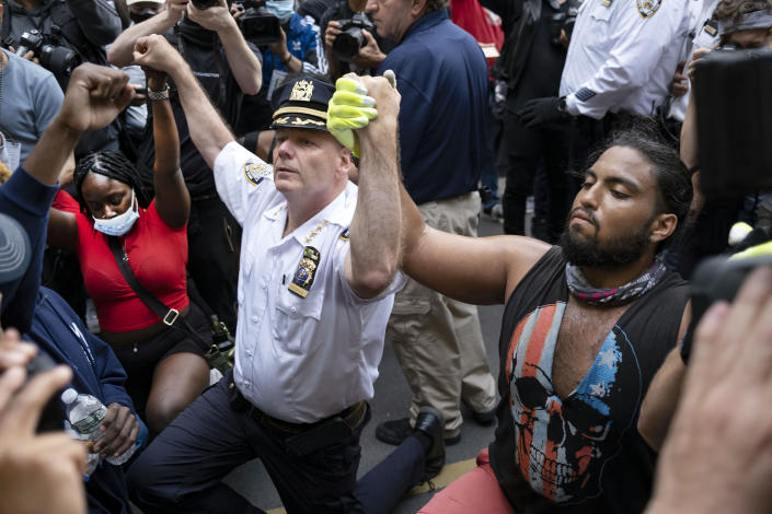 FILE — In this June 1, 202 file photo, Chief of Department of the New York City Police, Terence Monahan, kneels with activists as protesters paused while walking in New York. Monahan, who made headlines last year for kneeling with protesters while also being criticized for officers' forceful response, said Thursday, Feb. 25, 2021, that he is retiring after nearly four decades with the department. (AP Photo/Craig Ruttle, File)