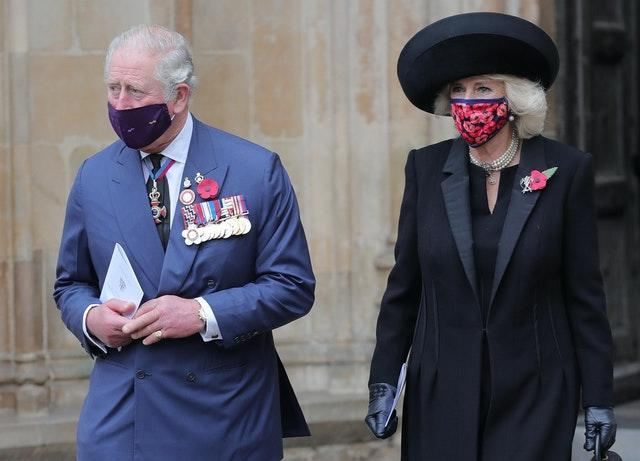 Charles and Camilla wore facemasks during the service like the rest of the congregation. Aaron Chown/PA Wire