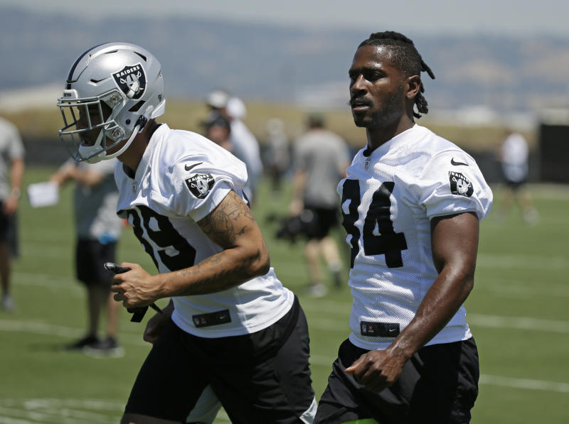 Oakland Raiders wide receivers Keelan Doss, left, and Antonio Brown warm up during NFL football minicamp Tuesday, June 11, 2019, in Alameda, Calif. (AP Photo/Eric Risberg)