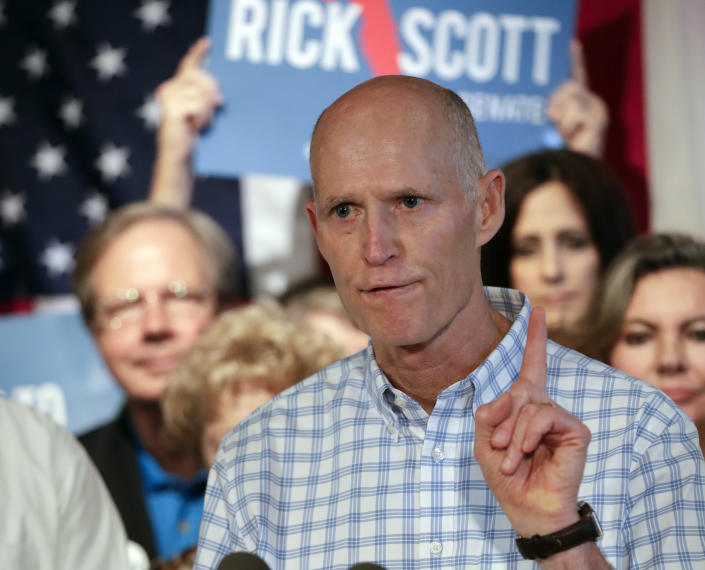 Florida Gov. Rick Scott speaks to supporters at a Republican rally. (Photo: John Raoux/AP)