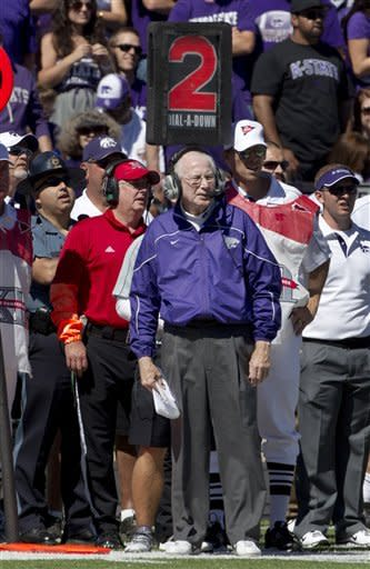 Kansas State coach Bill Snyder looks down the line during the first half of an NCAA football game against Miami in Manhattan, Kan., Saturday, Sept. 8, 2012. (AP Photo/Orlin Wagner)