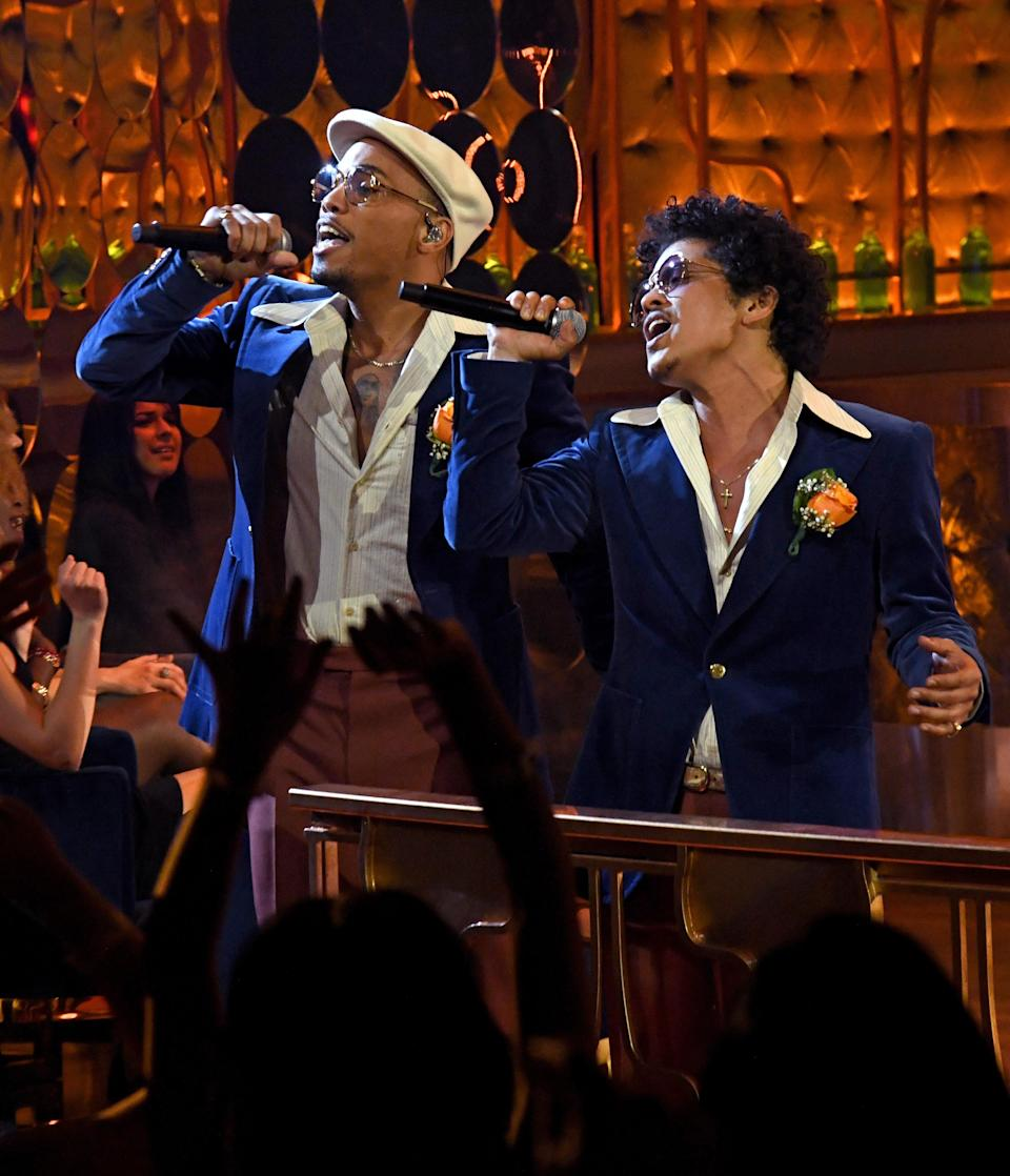Anderson .Paak and Bruno Mars took a time machine back to the '70s and looked effortless doing it. The pair wore matching blue blazers with a classic pop of orange.
