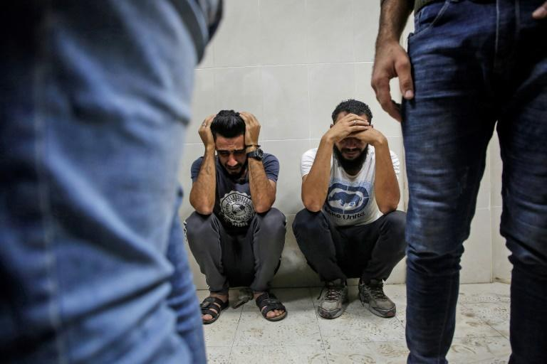 Relatives of Palestinian Zaki Ghanama, 25, mourn in the morgue of a hospital in Beit Lahia in the northern Gaza Strip