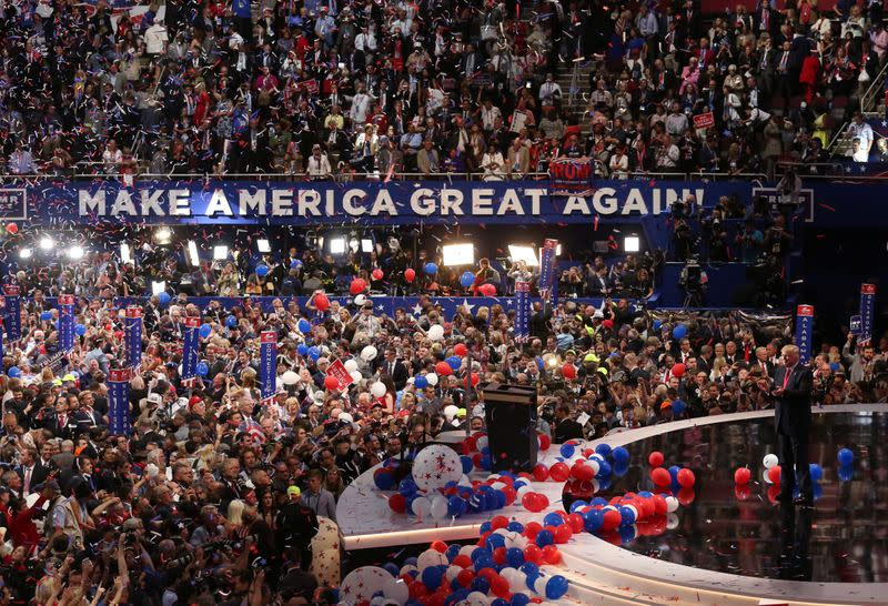 FILE PHOTO: Republican U.S. presidential nominee Donald Trump stands as balloons descend after his speech at the Republican National Convention in Cleveland