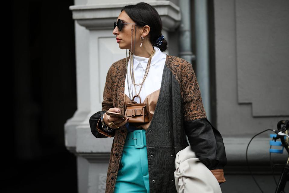 <p>If you're into packing just your essentials and love conversation-starting handbags, you may be into fashion's viral mini-bag trend. Sometimes it's nice to go lighter on the accessorizing, and 2021 takes the trend to new heights, welcoming - in addition to solid-colored top handles and crossbodies - mini shoulder bags and unique two-toned options.</p>