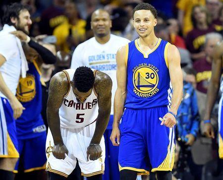 Jun 16, 2015; Cleveland, OH, USA; Golden State Warriors guard Stephen Curry (30) reacts next to Cleveland Cavaliers guard J.R. Smith (5) in the closing seconds of game six of the NBA Finals at Quicken Loans Arena. Mandatory Credit: Bob Donnan-USA TODAY Sports