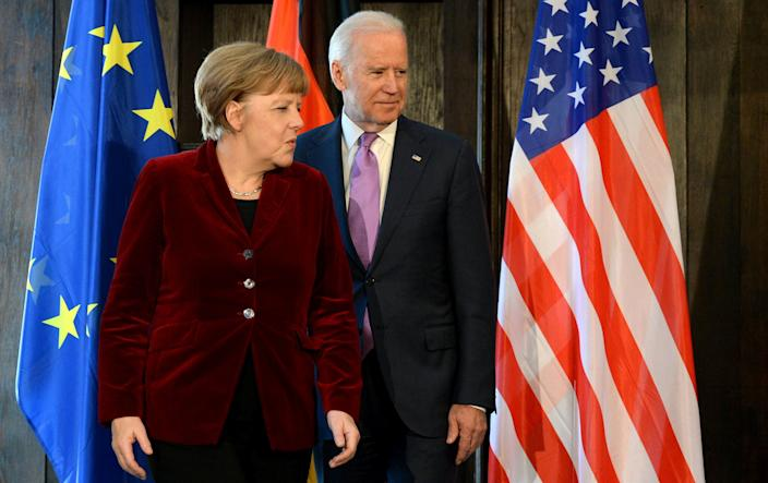 German Chancellor Angela Merkel and Vice President Joe Biden prior to their trilateral talks during the 51st Munich Security Conference (MSC) in Munich, southern Germany, Feb. 7, 2015.