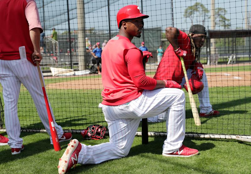 Philadelphia Phillies' Jean Segura watches batting practice at the Philadelphia Phillies spring training baseball facility, Tuesday, Feb. 19, 2019, in Clearwater, Fla. (AP Photo/Lynne Sladky)