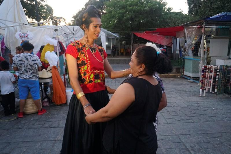 Estrella Vasquez, a muxe woman who features on the cover of Vogue magazine, is greeted by women in Juchitan