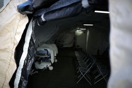 A triage surge tent is seen outside Loma Linda University Health Center for patients infected with an influenza A strain known as H3N2, in Loma Linda
