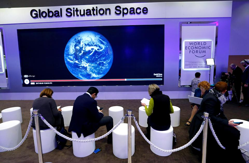 People are seen as they pause during the World Economic Forum (WEF) annual meeting in Davos, Switzerland January 24, 2018. REUTERS/Denis Balibouse