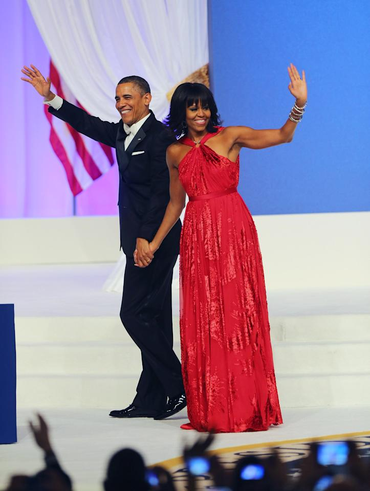 WASHINGTON, DC - JANUARY 21:  U.S. President Barack Obama and first lady Michelle Obama wave after dancing during the Commander-In-Chief's Inaugural Ball January 21, 2013 in Washington, DC. Obama was sworn in today for his second term in a public ceremonial swearing in..  (Photo by Joe Raedle/Getty Images)