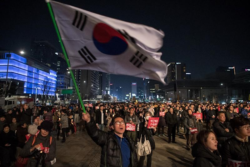 Anti-government protesters take part in a march in the South Korean capital Seoul on March 4, 2017