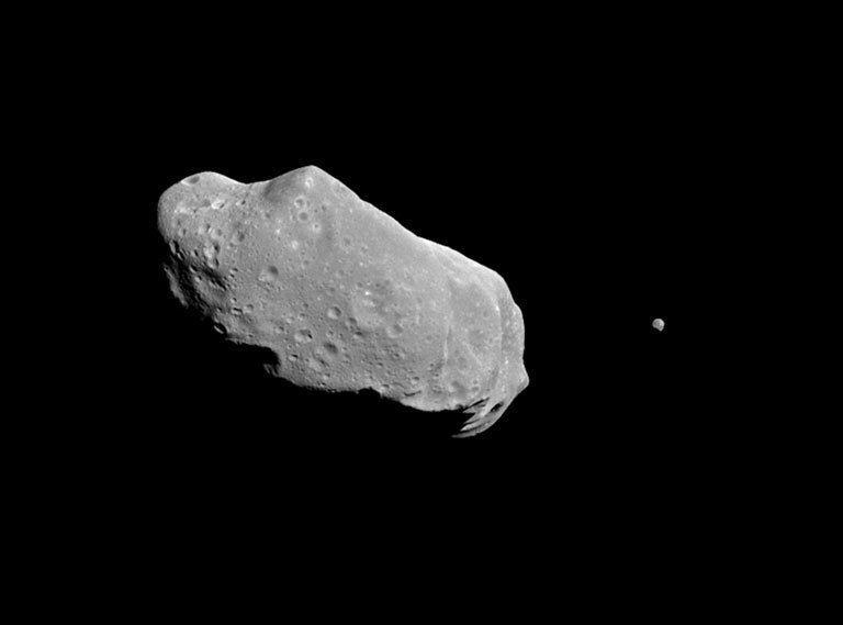 """<p>On Aug. 29, 1994, the Galileo spacecraft swung past 243 Ida. It was the second time a spacecraft had visited an asteroid, <a href=""""https://solarsystem.nasa.gov/asteroids-comets-and-meteors/asteroids/243-ida/in-depth/"""" rel=""""nofollow noopener"""" target=""""_blank"""" data-ylk=""""slk:according to NASA"""" class=""""link rapid-noclick-resp"""">according to NASA</a>. It is also the first asteroid discovered to have a moon. </p><p>Ida and its tiny moon, Dactyl, are located in the asteroid belt between Mars and Jupiter and are considered to be part of the Koronis family of asteroids, <a href=""""https://solarsystem.nasa.gov/asteroids-comets-and-meteors/asteroids/243-ida/in-depth/"""" rel=""""nofollow noopener"""" target=""""_blank"""" data-ylk=""""slk:according to NASA"""" class=""""link rapid-noclick-resp"""">according to NASA</a>. Like Gaspra, it is an S-type asteroid.</p>"""
