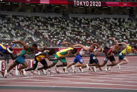Competitors start in their heat of the men's 100-meters with empty seats as a backdrop in the Olympic Stadium at the 2020 Summer Olympics, Saturday, July 31, 2021, in Tokyo. (AP Photo/Jae C. Hong)