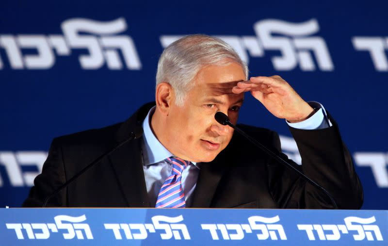 FILE PHOTO: Israel's PM Netanyahu gestures as he delivers his speech during his party's meeting for the upcoming Jewish New Year in Tel Aviv