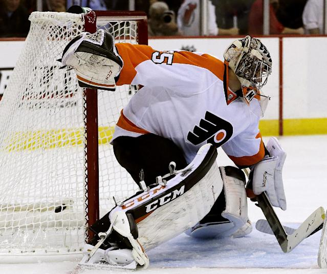 New Jersey Devils Damien Brunner, of the Czech Republic, scores a goal on Philadelphia Flyers goalie Steve Mason (35) during the second period of an NHL preseason hockey game, Thursday, Sept. 26, 2013, in Newark, N.J. (AP Photo/Julio Cortez)