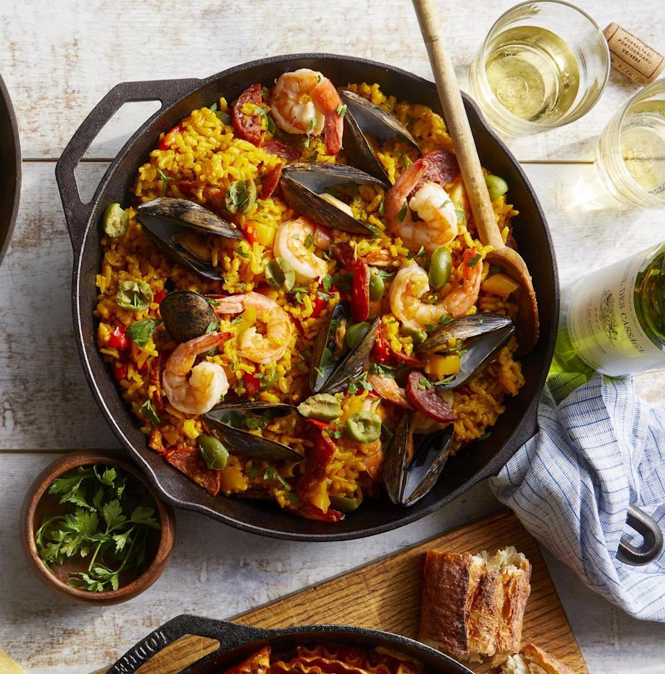"""<p>Pair this classic fancy Spanish dish with a flinty wine like Sauvignon blanc, or a dry rosé.</p><p><strong><a href=""""https://www.countryliving.com/food-drinks/a34946398/seafood-and-chorizo-paella-recipe/"""" rel=""""nofollow noopener"""" target=""""_blank"""" data-ylk=""""slk:Get the recipe"""" class=""""link rapid-noclick-resp"""">Get the recipe</a>.</strong></p><p><a class=""""link rapid-noclick-resp"""" href=""""https://www.amazon.com/Victoria-Skillet-Seasoned-Flaxseed-Certified/dp/B01726HD72/?tag=syn-yahoo-20&ascsubtag=%5Bartid%7C10050.g.1115%5Bsrc%7Cyahoo-us"""" rel=""""nofollow noopener"""" target=""""_blank"""" data-ylk=""""slk:SHOP CAST IRON SKILLETS"""">SHOP CAST IRON SKILLETS</a></p>"""