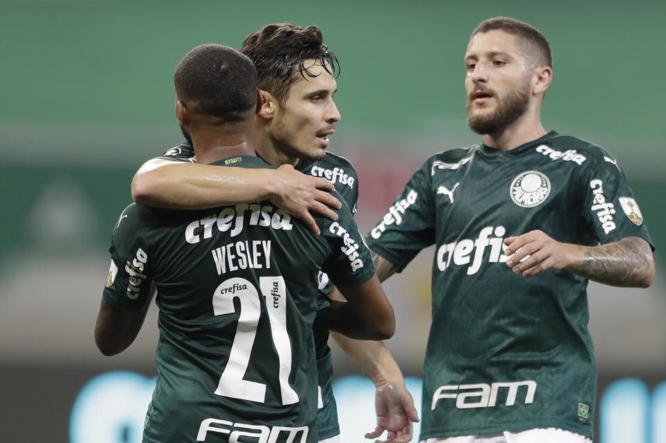 Brazil's Palmeiras midfielder Raphael Veiga (C) celebrates with teammates a goal against Argentina's Tigre during their closed-door Copa Libertadores group phase football match at the Arena Allianz stadium in Sao Paulo, Brazil, on October 21, 2020, amid the COVID-19 novel coronavirus pandemic. (Photo by Andre Penner / various sources / AFP) (Photo by ANDRE PENNER/AFP via Getty Images)