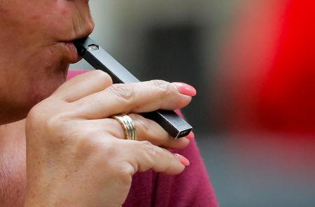 A woman smokes a Juul e-cigarette in New York