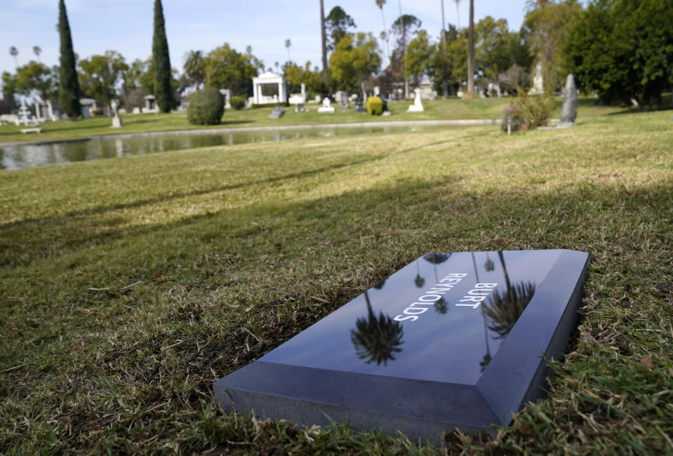 A temporary headstone for the late actor Burt Reynolds is pictured in the Garden of Legends section of Hollywood Forever cemetery, Thursday, Feb. 11, 2021, in Los Angeles. Reynolds' cremated remains were moved from Florida to Hollywood Forever, where a small ceremony was held Thursday. A permanent gravesite will be put up for Reynolds in a few months. (AP Photo/Chris Pizzello)