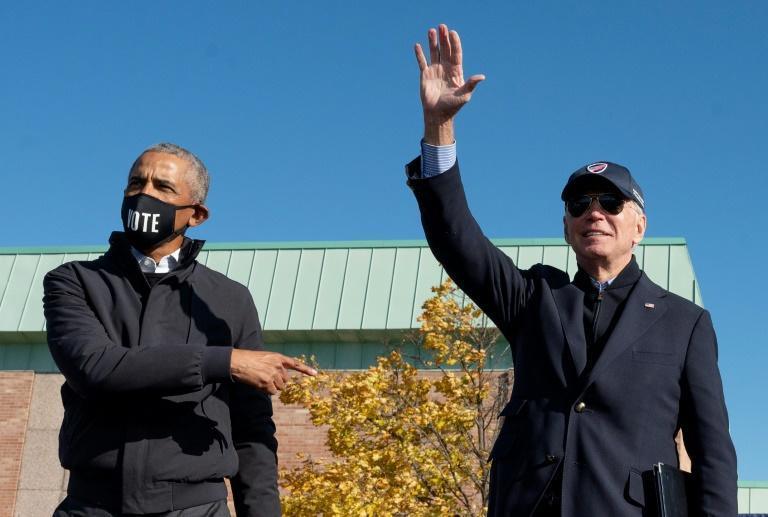Former US president Barack Obama campaigns with Democratic presidential candidate Joe Biden in Flint, Michigan on October 31, 2020
