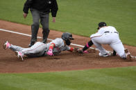 Boston Red Sox's Marwin Gonzalez, front left, is tagged out by Baltimore Orioles first baseman Ryan Mountcastle, right, on a pickoff during the third inning of a baseball game, Sunday, May 9, 2021, in Baltimore. (AP Photo/Nick Wass)