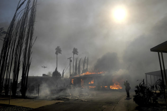 Firefighters battle the Sandalwood Fire as it destroys homes in the Villa Calimesa Mobile Home Park in Calimesa, Calif., on Thursday, Oct. 10, 2019. Burning trash dumped along a road sparked a wildfire Thursday that high winds quickly pushed across a field of dry grass and into a Southern California mobile home park, destroying dozens of residences. (Photo: Jennifer Cappuccio Maher/The Orange County Register/SCNG via AP)
