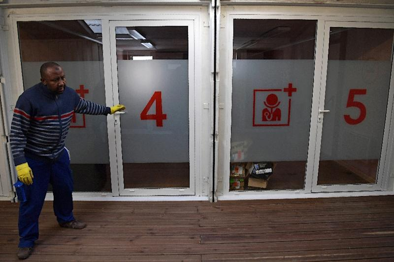 A worker checks medical facilities at a new refugee centre in northern Paris on November 8, 2016 (AFP Photo/Christophe Archambault)