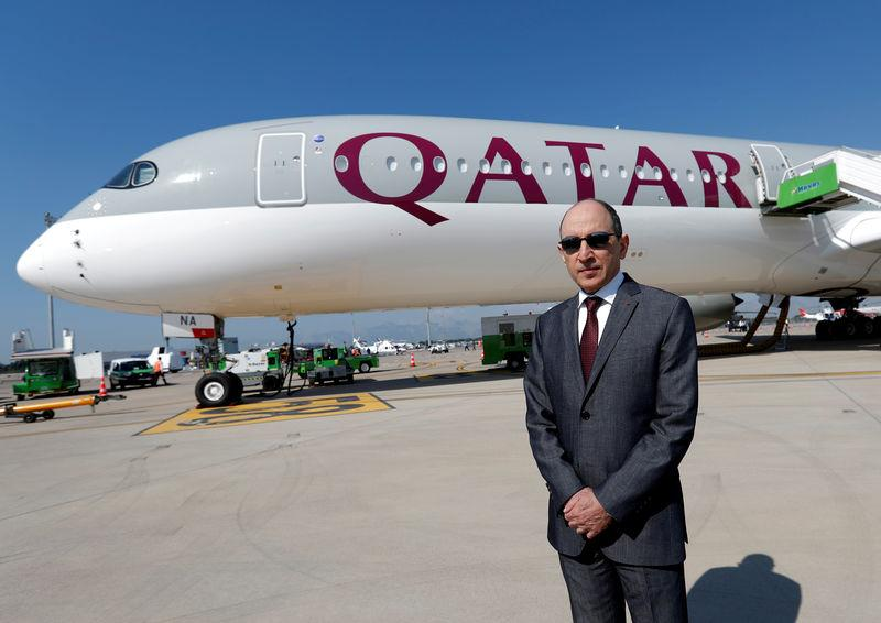 FILE PHOTO: Qatar Airways Chief Executive Officer Akbar al-Baker poses in front of an Airbus A350-1000 at the Eurasia Airshow in the Mediterranean resort city of Antalya