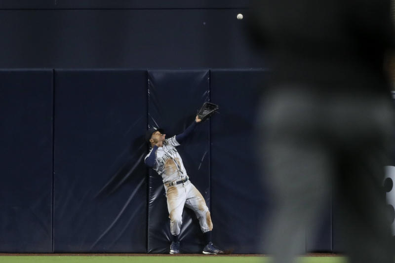 Seattle Mariners center fielder Mallex Smith can't make the catch on a two-run home run hit by San Diego Padres' Austin Hedges during the sixth inning of a baseball game, Tuesday, April 23, 2019, in San Diego. (AP Photo/Gregory Bull)