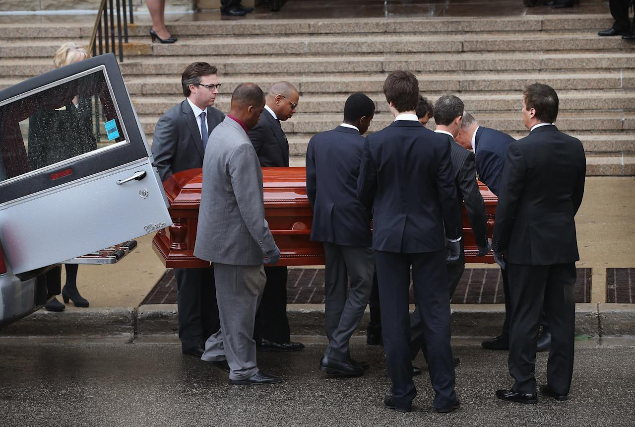 CHICAGO, IL - APRIL 08:  The remains of film critic Roger Ebert are carried into Holy Name Cathedral for is funeral service April 8, 2013 in Chicago, Illinois. Ebert died April 4, at the age of 70, after a long battle with cancer.  (Photo by Scott Olson/Getty Images)