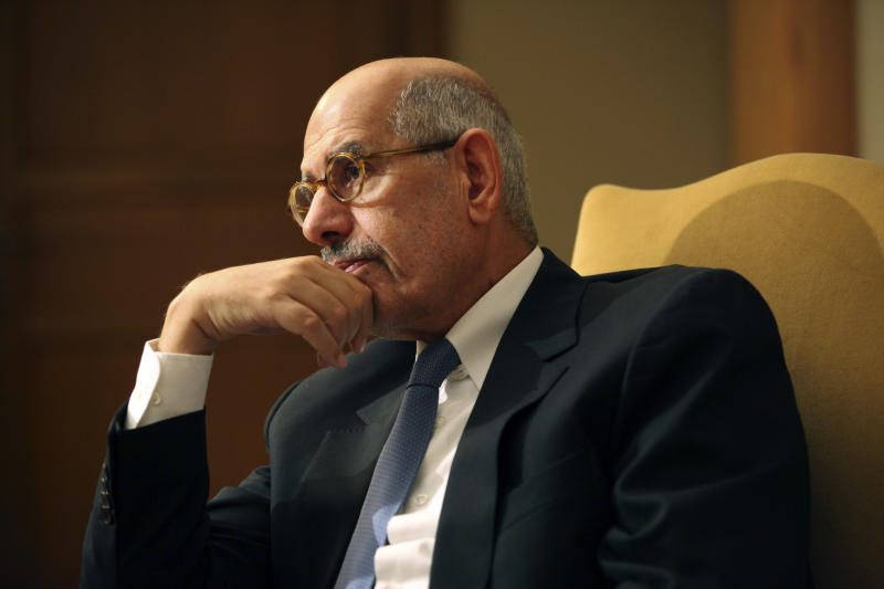 FILE - In this Saturday, Nov. 24, 2012 file photo, Leading democracy advocate Mohammed ElBaradei speaks to a handful of journalists including the Associated Press saying dialogue with Egypt's Islamist president is not possible until he rescinds his decrees giving himself near absolute powers, at his home on the outskirts of Cairo, Egypt. Egypt's main opposition coalition announced on Tuesday it will boycott upcoming parliamentary elections, a decision likely to deepen the nation's political crisis and worsen an already troubled economy. (AP Photo/Thomas Hartwell, File)