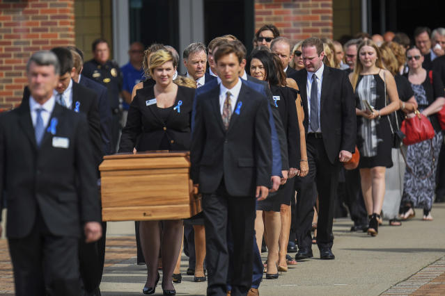 <p>The casket of Otto Warmbier is carried from Wyoming High School after his funeral, Thursday, June 22, 2017, in Wyoming, Ohio. (Photo: Bryan Woolston/AP) </p>