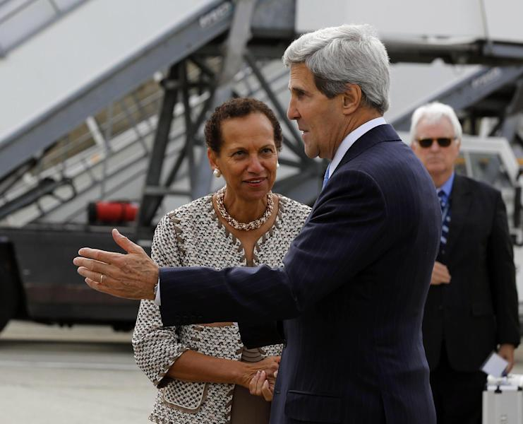 U.S. Secretary of State John Kerry, foreground, is welcomed by the U.S. Permanent Representative to the United Nations in Geneva Amb. Betty E. King, on arrival at Cointrin Airport, in Geneva, Thursday, Sept. 12, 2013, prior to his meeting with Russian Foreign Minister Sergey Lavrov to discuss the ongoing problems in Syria. (AP Photo/Larry Downing, Pool)