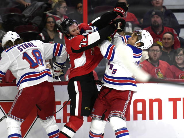 Ottawa Senators defenseman Thomas Chabot (72) tangles with New York Rangers center Vladislav Namestnikov (90) during the first period of an NHL hockey game, Saturday, Oct. 5, 2019 in Ottawa, Ontario. (Justin Tang/The Canadian Press via AP)