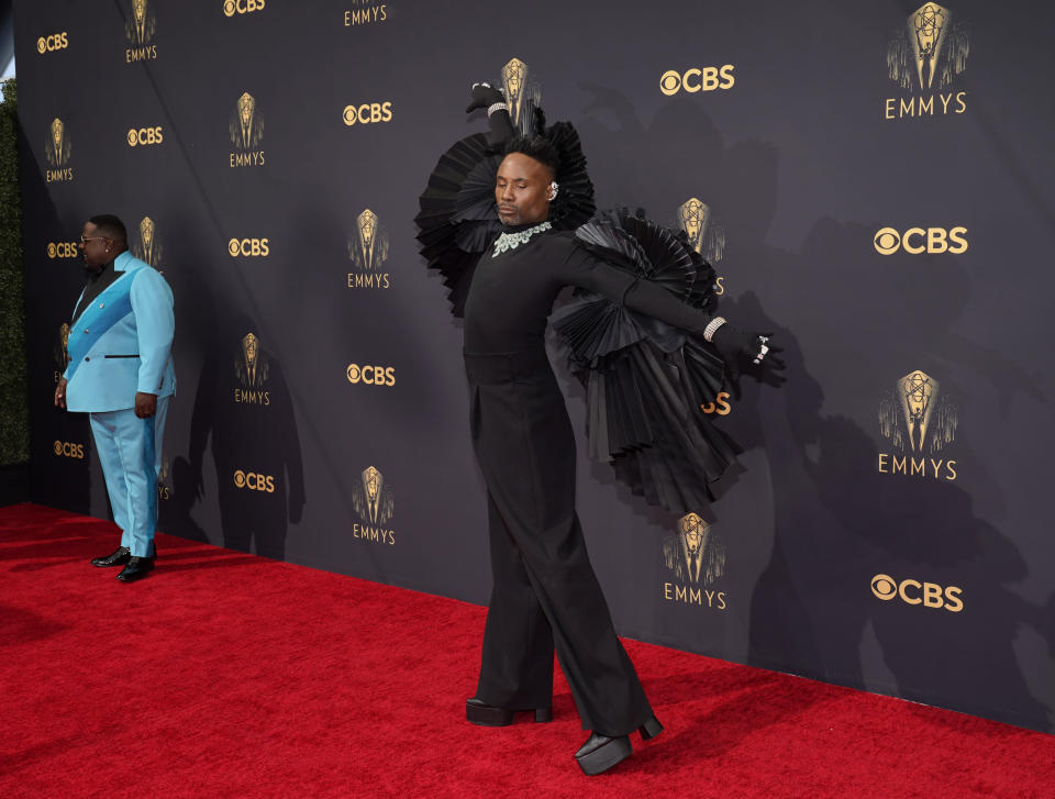Cedric the Entertainer, left, and Billy Porter arrive at the 73rd Primetime Emmy Awards on Sunday, Sept. 19, 2021, at L.A. Live in Los Angeles. (AP Photo/Chris Pizzello)