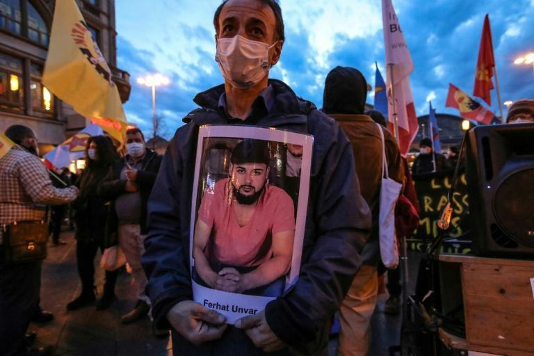 12 months after the deadly shootings at a shisha bar and a cafe, victims' relatives say too little has been done to shed light on the attack and ensure that such atrocities will not be repeated