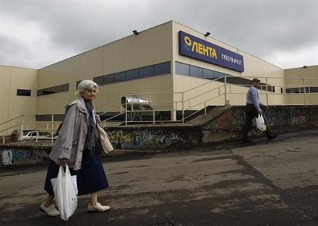 Shoppers walk past a Lenta supermarket in Moscow