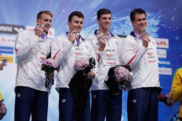 U.S. swimmers pose after winning gold medals at the Pan Pacific Championships – gold medals that were later revoked after the USA relay team was disqualified for swimming out of order. (Getty)