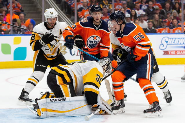 Edmonton Oilers' Ryan Nugent-Hopkins (93) and Kailer Yamamoto (56) attack Pittsburgh Penguins goaltender Matt Murray (30) during the second period of an NHL hockey game, in Edmonton, Alberta, Tuesday, Oct. 23, 2018. (Codie McLachlan/The Canadian Press via AP)
