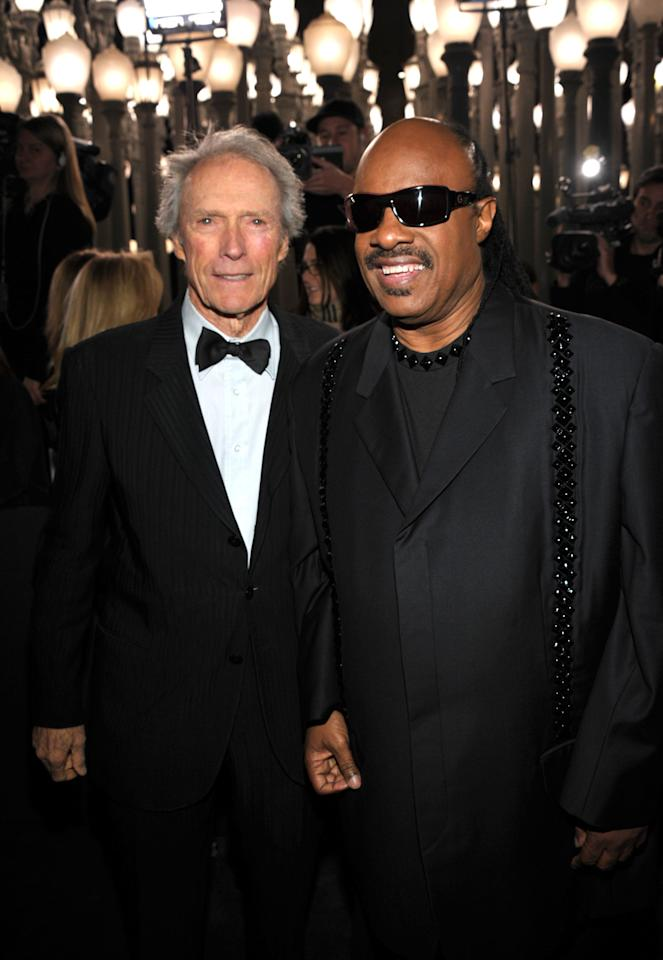 LOS ANGELES, CA - NOVEMBER 05:  Honoree Clint Eastwood (L) and musician Stevie Wonder attend LACMA Art + Film Gala Honoring Clint Eastwood and John Baldessari Presented By Gucci at Los Angeles County Museum of Art on November 5, 2011 in Los Angeles, California.  (Photo by John Shearer/Getty Images for LACMA)