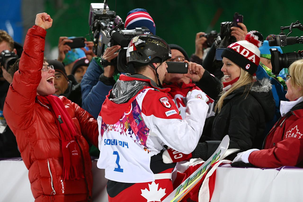 SOCHI, RUSSIA - FEBRUARY 10: Gold medalist Alex Bilodeau of Canada celebrates with his family after the flower ceremony for the Men's Moguls Finals on day three of the Sochi 2014 Winter Olympics at Rosa Khutor Extreme Park on February 10, 2014 in Sochi, Russia. (Photo by Cameron Spencer/Getty Images)