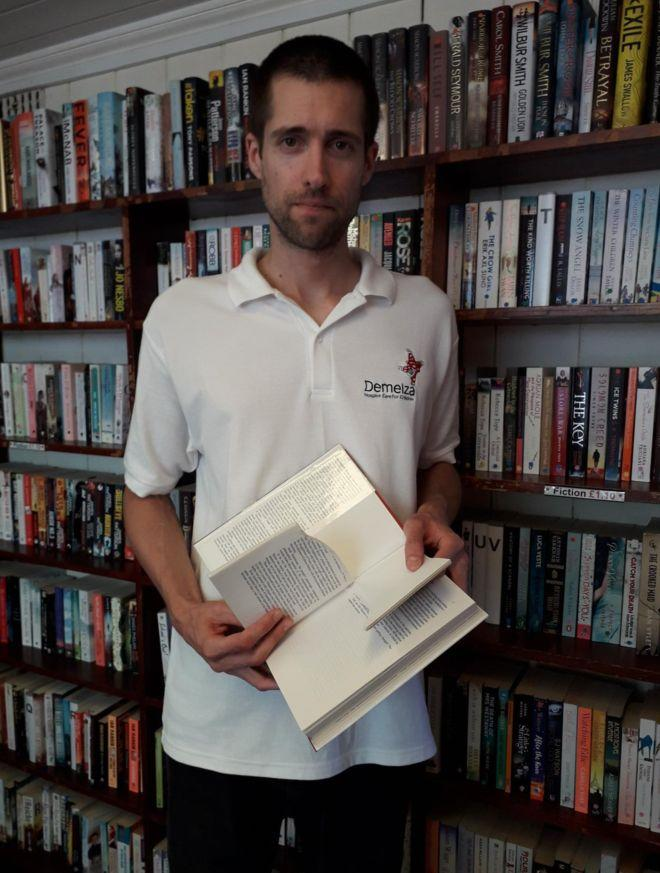 Nick Rogers with one of the books damaged by the Herne Bay Book Ripper. (Nick Rogers)